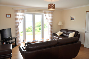 Shorefield self catering luxury accommodation - the sitting room with views over Loch Harport.