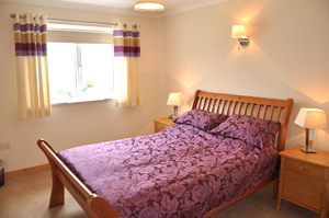 A double bedroom with views over Loch Harport
